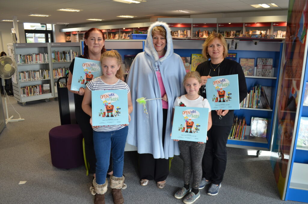 Fenella the Fairy Tooth Godmother with staff and visitors to The Beacon Library